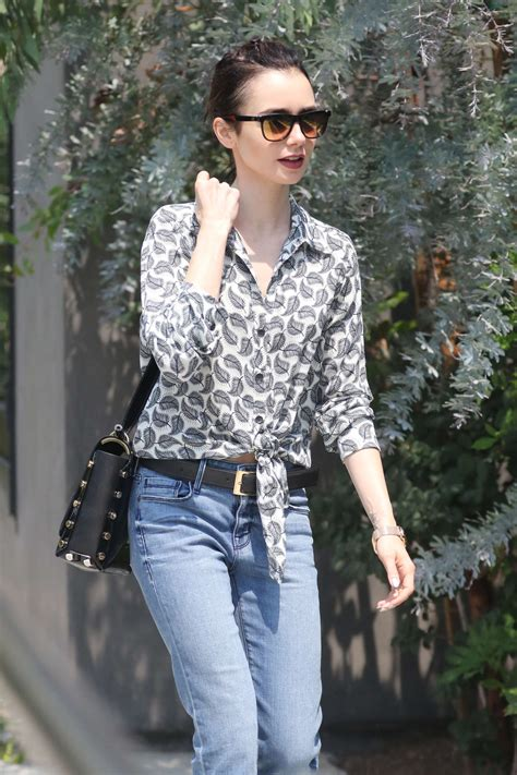 Lily Collins in Jeans visit at the salon in Beverly Hills