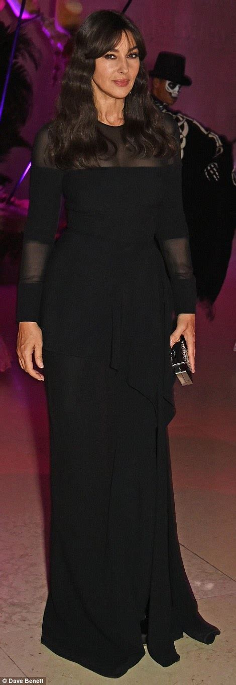 Naomie Harris flashes sideboob at Day Of The Dead themed